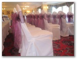 Wedding chair covers and organza sashes in Gomersal